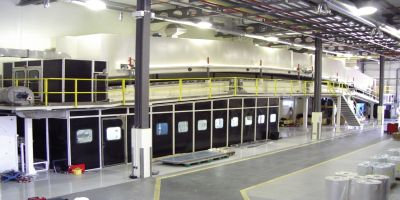 Doel Engineering coating line with an accumulator, a laminator, two turret unwinds, a turrent rewind, and a gas fired - four zone - air contra-flow - air impingement dryer